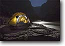 Stock photo. Caption: Moonlit tent at Ledges Camp Colorado River Grand Canyon National Park Colorado Plateau, Arizona -- united states america artistic nature camping camp campers camper tents moonlight southwest adventure raft trip outdoor recreation night evening rock rocks water rivers peaceful parks wild sleep sleeping people  yellow