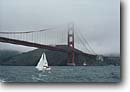 Stock photo. Caption: Golden Gate Bridge San Francisco Bay California -- bridges suspension united states america towers area transportation highway highways freeway travel touristdestination destinations  sailing sailboat people boat boats pleasure craft crafts landmarks landmark