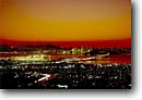 Stock photo. Caption: San Francisco-Oakland Bay Bridge   and San Francisco from Berkeley Hills Berkeley, California -- cityscape cityscapes bridges dusk city cities bays light landscape landscape western west coast shoreline shore scenic scenics