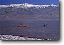 Stock photo. Caption: Kayaking after a wet winter at Badwater Telescope Peak from Death Valley Death Valley National Park Mojave Desert,  California -- mohave deserts desert kayak people unusual anomoly rare outdoor recreation below sea level parks snow capped peaks contrast boating kayak kayaker kayakers
