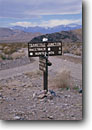 Stock photo. Caption: Road sign Tea Kettle Junction Death Valley National Park Mojave Desert,  California -- united states america parks roads signs comical teakettles kettles amusing direction destination travel backroad backroads scenic drive drives junctions remote direction directions