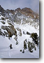Stock photo. Caption: Ski touring below the Paiute Crags John Muir Wilderness Sierra Nevada California -- mountain high country sierras backcountry highcountry cross country skier skiing winter snow skiers snowy crosscountry outdoor recreation extreme sport sports wildernesses landscape landscapes scenic scenics cold wild dogs pets animal animal people person