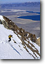 Stock photo. Caption: Backcountry skier on Nevahbe Ridge Crowley Lake from John Muir Wilderness Inyo National Forest Sierra Nevada, California -- mountain high country sierras backcountry highcountry cross country skier skiing winter snow crosscountry outdoor recreation extreme sport sports wildernesses landscape landscapes scenic scenics cold wild people person sunny clear skiers
