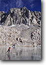 Stock photo. Caption: Ice skating in the Sierra backcountry  the Palisades from Dusy Basin Kings Canyon National Park Sierra Nevada, California -- united states america high mountain high country sierras backcountry people highcountry winter snow snowy crosscountry outdoor recreation unusual skater frozen lake lakes alone unique freedom challenge extreme sport sports