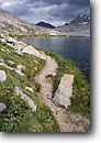 Stock photo. Caption: Wanda Lake below Muir Pass John Muir Trail, Pacific Crest Trail Kings Canyon National Park Sierra Nevada,  California -- Keywords: trails parks high mountain country sierras backcountry highcountry outdoor recreation freedom challenge backpacking timberline alpine above landscape landscapes hiking famous  known cloudy overcast scenics scenic inviting backpack silence quiet summer