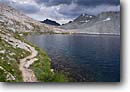 Stock photo. Caption: Wanda Lake below Muir Pass John Muir Trail, Pacific Crest Trail Kings Canyon National Park Sierra Nevada,  California -- Keywords: trails parks high mountain country sierras backcountry highcountry outdoor recreation freedom challenge backpacking timberline alpine above landscape landscapes hiking famous known cloudy overcast scenics scenic inviting backpack silence quiet summer path