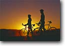 Stock photo. Caption: Road bikers at sunset Eastern Sierra Nevada Mono County California -- united states america adventure mountains outdoor recreation bicycle bicycles bikes silhouette silhouettes sunsets lifestyle biking couple friendship people sports sport bike landscape landscapes scenic scenics sunsets riding