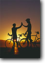 Stock photo. Caption: Road bikers at sunset Eastern Sierra Nevada Mono County California -- united states america adventure mountains outdoor recreation bicycle bicycles bikes silhouette silhouettes sunsets lifestyle biking couple friendship people sports sport landscape landscapes scenics scenic forms abstract riding ride