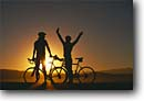 Stock photo. Caption: Road bikers at sunset Eastern Sierra Nevada Mono County California -- united states america adventure mountains outdoor recreation bicycle bicycles bikes silhouette silhouettes sunsets bikers lifestyle biking couple friendship people sports sport landscapes landscapes forms scenics scenic riding