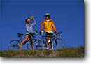 Stock photo. Caption: Road bikes Eastern Sierra Nevada Mono County California -- united states america adventure mountains outdoor recreation bicycle bicycles bikes bikers lifestyle biking couple friendship mountain people sports sport sunny blue skies clear lifestyles riding