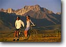 Stock photo. Caption: Road bikes and Mt. Morrison Eastern Sierra Nevada Mono County California -- united states america adventure mountains outdoor recreation bicycle bicycles bikes bikers lifestyle biking couple friendship mountain people sports sport sunny blue skies clear lifestyles  bike riding