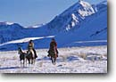 Stock photo. Caption: Couple rides the range  and McGee Mountain Inyo National Forest Mono County Sierra Nevada, California -- united states america person people cowboys ranching ranch lifestyle horses horse horseman cowboy portrait portraits cowgirl cowgirls snow snowy winter sierras horseback