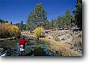 Stock photo. Caption: Fly fishing near Big Spring Upper Owens River Inyo National Forest California -- Keywords: united states solitude fisherman mountains sierras fish trout leisure fly fishing flyfisherman casting cast flycasting people america rivers forests summer solitude idyllic angler anglers angling flyfishing