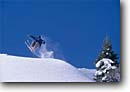 Stock photo. Caption: Mammoth Mountain Ski Area Inyo National Forest Eastern Sierra Nevada Mono County,  California -- Keywords: people outdoor recreation winter freedom solitude excitement skiing  snow blue skies clear mountains forest sierras expanse vast alone single person experience range pacific crest skier skiers sports sport alpine jumping downhill catching