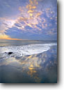Stock photo. Caption: Sunset Santa Barbara Beach Santa Barbara California -- landscape landscapes scenic scenics ocean beaches seashore seashores seascape seascapes waves sandy clouds sunsets western west inviting patience enduring sweet quiet places