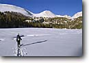 Stock photo. Caption: Cross country skiing,  Crabtree Meadow Pacific Crest Trail,   John Muir Trail Sequoia  National Park Sierra Nevada,  California -- people outdoor recreation crosscountry freedom solitude excitement skiing wildernesses snow blue skies clear tracks track mountains forest sierras expanse vast alone single person experience range pacific crest skier skiers sports sport winter