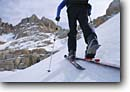 Stock photo. Caption: Cross country skier   traversing below Mt. McAdie Sequoia  National Park Sierra Nevada, California -- people outdoor recreation crosscountry freedom solitude excitement skiing wildernesses snow tracks track mountains sierras expanse vast alone single person parks range skiers sports sport cold winter scenic landscape landscapes traverse scenics