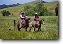 Stock photo. Caption: Cowboys ride the Guidetti Ranch South Coast Ranges San Luis Obispo County California -- united states america person people cowboy ranching ranch lifestyle range western heritage wrangler wrangling cowpoke  roots land independant determined proud work ethic horses horse working rope roping ropes cattle chaps saddle riding horseback
