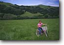 Stock photo. Caption: Bike riding   at the Irish Hills South Coast Ranges San Luis Obispo County, California -- united states america bicycle bicycles bikes bikers children girl people kids child landscape landscapes scenics scenic