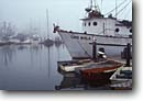 Stock photo. Caption: Boats in fog Morro Bay San Luis Obispo County California -- harbors commercial fishing boat vessels vessels harbour harbours quaint village villages united states america summer southeast town towns docks dock wharf wharfs morning clear dinghy dinghys seascape seascapes