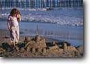 Stock photo. Caption: Pismo Beach San Luis Obispo County California -- united states america person people kid children child sand castle sandcastle castles sandcastles playing pier beaches