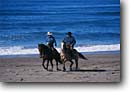 Stock photo. Caption: Horseback on the beach Montana de Oro State Park Central Coast San Luis Obispo County, California -- united states america person people cowboy ranching ranch lifestyle western heritage horses horse riding  pleasure horseback cowboys waves