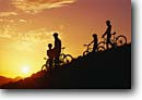 Stock photo. Caption: Family bike ride at sunset San Luis Obispo County Central Coast California -- united states america bicycle bicycles bikes bikers children together togetherness silhouette silhouettes sunsets outdoor recreation people sports sport clear lifestyles child children