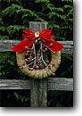 Stock photo. Caption: Christmas wreath  and Port Orford cedar -- decorations decoration christmassy wreaths hanging fence fences festive split redwood rail faith eternal holiday holidays tree trees cedars season winter