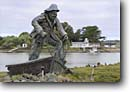Stock photo. Caption: Fisherman Statue and Indian Island   from Woodley Island Marina Humboldt Bay, Eureka Humboldt County,  California -- attraction attractions destination destinations waterfront waterfronts harbors harbor marinas landmark landmarks statues boat boats fishing commercial port ports island native american recreation district commerce historic historical town towns cities