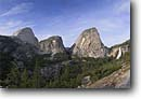 Stock photo. Caption: Half Dome, Liberty Cap and Nevada Falls John Muir Trail Yosemite National Park Sierra Nevada,  California -- united states america summer highcountry backcountry sierras landscape landscapes granite mountain mountains scenic domes glacial glacially carved waterfall waterfalls valley wilderness wildernesses alpine cloud clouds tree trees valleys  parks