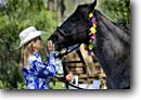 Stock photo. Caption: Connie Bender and her horse Blue Waimea Cherry Blossom Heritage Festival South Kohala Island of Hawaii, Hawaii -- stable horse horses cowgirl cowgirls animal affection