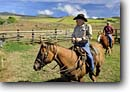 Stock photo. Caption: Legendary Big Island Cowboy (Paniolo) Freddy Rice and his daughter Lilah on their ranch, Kohala Mountains North Kohala, Island of Hawaii, Hawaii -- horse horses ranches paniolos cowboys livestock hawaiian tropical
