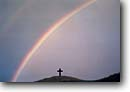 Stock photo. Caption: Rainbow over Hana Cross Hana Highway Island of Maui, Hawaii -- landscape landscapes scenic scenics  inviting patience enduring sweet quiet places religious faith rainbows happiness crosses symbols symbols religion beliefs believe miracle miracles holy calm hawaiian tropical tropics destination destinations