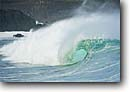 Stock photo. Caption: Winter swells at Waimea Bay Island of Oahu Hawaii Central Pacific Ocean -- hawaiian tropical tropics landscape landscapes wave waves landmarks landmark legendary legends giant swell surf break surfing breaks islands blue water curls curl scenic scenics north shore shores northshore famous tropic  destination destinations tourist