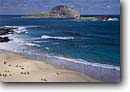 Stock photo. Caption: Manana and Kaohikaipu Islands Makapuu Beach County Park Island of Oahu Hawaii -- tropical destination destinations tourist islands united states america parks people hawaiian beaches sandy sunbathing sand vacation family surf waves swimming landmarks landmark landscape landscapes tropics ocean tourists