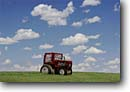 Stock photo. Caption: Hay tractor Highway 36 Marshall County Kansas -- scenics landscape landscapes united states prairie prairies cloud great plains vast western west scenic cumulonimbus blue skies tractors bales rolled humor humour humourous country funny advertisement roadside cute idea laugh eyecatching whimsy whimsical