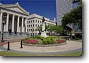 Stock photo. Caption: Lafayette Park (Post Katrina) New Orleans Louisiana -- city cities sunny clear historic historical scenic destination destinations landmark landmarks attractions attraction district districts spring warm streets scenics parks statues statue flowers plaza plazas columns buildings building ornate
