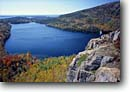 Stock photo. Caption: Jordan Pond Acadia National Park Mount Desert Island Maine, New England -- vacation united states america parks scenic peaks landscapes tourist destination destinations placid lake lakes cliff cliffs fall autumn foliage blue sunny clear deep people person woman women view vista views vistas scenics overlooking