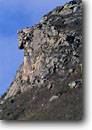 Stock photo. Caption: Old Man of the Mountain (now gone) White Mountains Franconia Notch State Park New England,  New Hampshire -- united states america icon icons rock face faces  erosion parks fall features granite landmark landmarks landscape landscapes sunny clear blue skies rocks famous past scenics scenic
