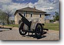 Stock photo. Caption: Artillery piece and Guardhouse Fort Sill National  Historic Landmark and Museum Comanche County,  Oklahoma -- historical destination destinations attractions spring tourist attraction scenics heritage american history forts protection westward settlement pioneers expansion civil buildings building indian western west wars military landmarks cannons exhibits
