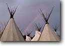 Stock photo. Caption: Tipis at the Pendleton Roundup Pendleton Oregon -- united states america tipi roundups rainbow rainbows native americans village villages rendevous indian conical teepee teepees powwow landscape landscapes scenic views scenes shelter gathering gatherings