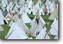 Stock photo. Caption: Tipis at the Pendleton Roundup Pendleton Oregon -- united states america tipi roundups rainbow rainbows native americans village villages rendevous indian conical teepee teepees powwow landscape landscapes scenic views scenes shelter gathering gatherings forms form shapes repetitive
