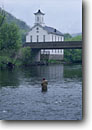 Stock photo. Caption: Fly fishing on Little Juniata River   at Spruce Creek Huntingdon County Pennsylvania -- united states flyfishing fisherman spring mountains outdoor recreation vacation trout stream streams river rivers fishermen church churches faith praying pray hope people angler anglers angling rural bridge bridges sport freshwater blue ribbon famous runs
