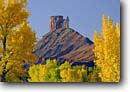 Stock photo. Caption: Fremont cottonwoods frame Priest and Nuns on Castle Rock Colorado Riverway Colorado Plateau, Utah -- canyon country balance mountain mountains parks sandstone balance strength rocks blue skies clear sunny fall autumn landscape landscapes scenic views view scenics slickrock  rectory landmark landmarks climbing destination destinations named features