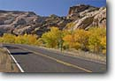 Stock photo. Caption: Highway 24 along the San Rafael River Waterpocket Fold Capitol Reef National Park Colorado Plateau, Utah -- united states fall autumn canyon country parks plateaus canyons desert deserts sunny landscape landscapes clear skies scenic scenics road roads inviting wide open spaces slickrock travel transportation destination destinations tourist attraction highways