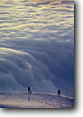 Stock photo. Caption: Climbers above the clouds Challenger Glacier,  Picket Range North Cascades National Park North Cascades,  Washington -- united states america people person climb climbing mountain action sport sports extreme outdoor recreation climber activity glaciers cloudy cloud northwest northwestern pacific state cover vista moody mood landscape landscapes white scenics scenic views