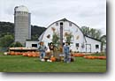 Stock photo. Caption: Fall produce stand Great River Road, Highway 35 Mississippi River Valley Pepin County,  Wisconsin -- autumn parks midwest upper midwestern landscape landscapes scenic scenics attractions attraction destination destinations tourist travel seasonal decorations decoration halloween barn barns stands pumpkins pumpkin scarecrows scarecrow farm farms fruit