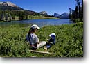 Stock photo. Caption: Relaxing on the Green River Wind River Range Bridger-Teton National Forest Rocky Mountains,  Wyoming -- united states rockies fishermen women woman flycasting creeks river rivers stream streams summer activiies leisure recreation freshwater sport outdoor wild fishery fisheries sunny family relaxing child children mother mothers