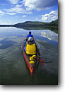 Stock photo. Caption: Canoeing   the Coppermine River Northwest Territories Canada -- boat boating boater boats canoe canoes kayak kayaks kayaking paddling canadian rivers clouds people woman women reflection reflections outdoor recreation adventure northwestern northern canoer sports sport canoers landscapes landscape kayaker kayakers
