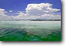 Stock photo. Caption: Double-Breasted Cay Ragged Island Chain Bahamas Atlantic Ocean -- scenic scenics ocean oceans bahama tropical warm tourist destination destinations dive diving site sites clear water clean sandy beach beaches secluded palms beautiful clouds idyllic ideal perfect  seascape seascapes